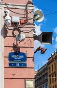 Surveillance cameras and loudspeakers - stock photo
