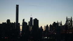 Midtown Manhattan and Queensboro Bridge in NYC at sunset Stock Footage