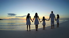 Caucasian parents and female children sunset silhouette on the beach Stock Footage