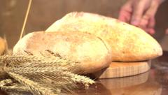 Bread and wheat ears on the table. Stock Footage