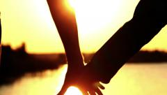 Father and Son Holding Hand At River Sunset, silhouettes Stock Footage