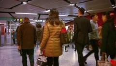 High speed motion video of passengers walking through a busy subway station Stock Footage