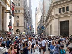 Tourists at Wall Street near the Federal Hall in Manhattan Stock Photos