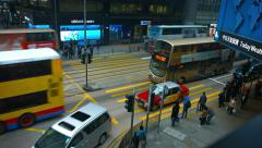 Taxis, busses and electric cable cars crossing through a busy urban intersection Stock Footage