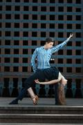 Stock Photo of Girl bent in the dance, guy supports it.