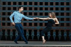 Guy with a girl dancing in the street dancing. Stock Photos