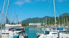 Many luxury, fiberglass sailboats docked at Langkawi's peaceful harbor. Stock Footage