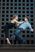 Young couple dancing the tango. Stock Photos
