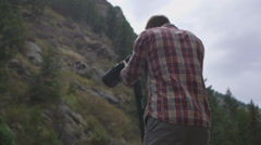 Man with camera long lens Stock Footage