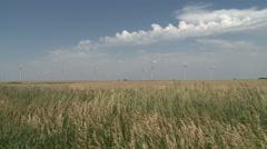 Prairie Winds Blwo Through Wheat Fields and Wind Farm Stock Footage