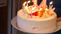 Birthday cake and party for a 14 year old. - stock footage
