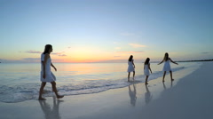 Young Caucasian parents and daughters on the beach by the ocean Stock Footage