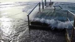 Wave breaks over rock pool slow motion Mona Vale NSW Australia Stock Footage
