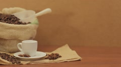 Coffee beans in jute bag with coffee grinder and hot cup of coffee Stock Footage