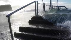 Wave breaks over rock pool MS slow motion Mona Vale NSW Australia. Stock Footage