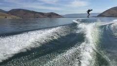 SLOWMOTION: Wakeboarding Toeside frontside 360 wake to wake Stock Footage