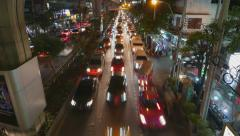 Crowded traffic accumulate to blockage at night city road, TIMELAPSE from above Stock Footage