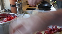 Making a strawberry crepe breakfast Stock Footage