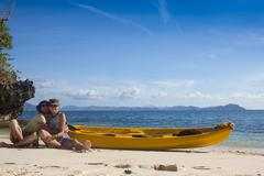 Couple canoeing in lagoon of West  French indies Kuvituskuvat