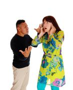 Man yelling on his frustrated wife. - stock photo