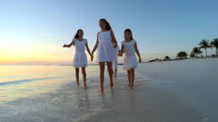 Loving male female Caucasian family on tropical beach at sunrise Stock Footage