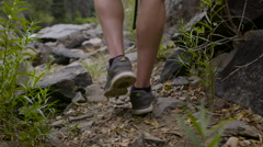 Man walking on river trail Stock Footage