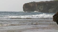 Gentle Surf on rocky Hawaii coast Stock Footage