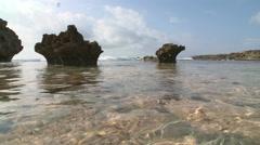 Clear Water on Hawaii Coast between volcanic rocks Stock Footage