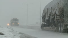 Slick Highways in snow storm with semi trucks Stock Footage