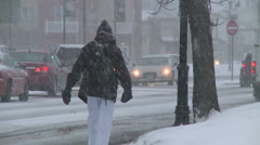 Trudging Through Snowy Streets in Minnesota Stock Footage