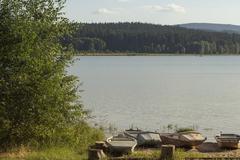 Small fisherman boats on lake Lipno in south Bohemia, Czech Republic, Europe - stock photo