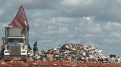 Trash Being Burried by Machines at Solid Waste Landfill Stock Footage