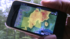 Mobile Weather Radar App on Smart Phone Stock Footage