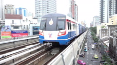 BTS sky train coming to Thonglor station and Bangkok city view Stock Footage