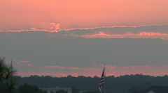 Big Southern Sunset Behind American Flag Stock Footage