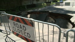 Water Mark Dangerous Sink Hole in Closed Road Stock Footage