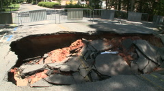 Washed Out Sink Hole Destroyed Road Stock Footage