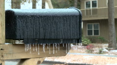 Sleet and Freezing Rain Pelt Mailbox in Winter Storm - stock footage