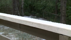 Dancing Ice and sleet on porch railing Stock Footage