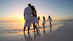 Young Caucasian parents and daughters playing on the beach Stock Footage
