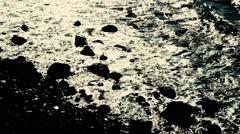 Waves washing onto a sandy beach Stock Footage