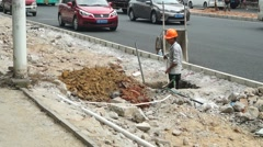 Chinese workers in pavement construction Stock Footage