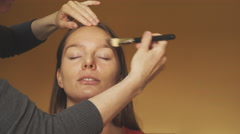 Stock Video Footage of Make-up artist applying foundation to model face 4K
