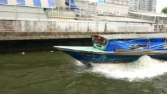 Stock Video Footage of Powerful express boat rushes along city channel, tracking shot