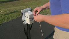 Preparing a Weather Balloon Radiosonde Package for Launch Stock Footage