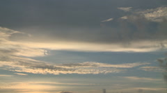Pan of Feathery Clouds in Sky at Sunset - stock footage