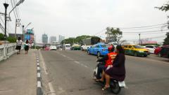 Road bridge over canal, POV camera move along sidewalk, crowded asian traffic Stock Footage