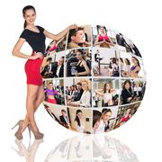 Woman stands beside collage sphere - stock photo