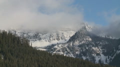 Snow Clouds Massing on Western Mountains Stock Footage
