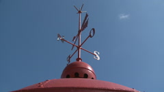 Historic Wind Vane Atop Building on Sunny Day Stock Footage